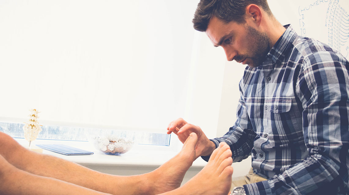 How can foot orthoses help with injury?
